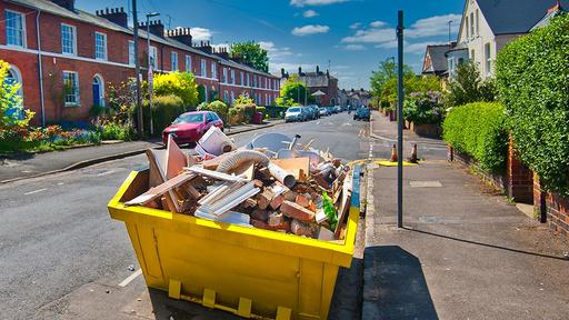 Domestic skip hire filled with debris